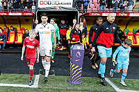 (L-R) Team captains Federico Fernandez of Swansea City and Heurelho Gomes of Watford lead their team onto the pitch during the Premier League match between Watford and Swansea City at the Vicarage Road, Watford, England, UK. Saturday 30 December 2017