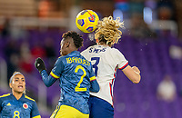 ORLANDO, FL - JANUARY 18: Kelly Ibarguen #2 of Colombia goes up for a header with Samantha Mewis #3 of the USWNT during a game between Colombia and USWNT at Exploria Stadium on January 18, 2021 in Orlando, Florida.
