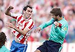 Atletico de Madrid's Diego Godin against Barcelona's Gerard Pique during La liga match. September 19, 2010. (ALTERPHOTOS/Alvaro Hernandez).