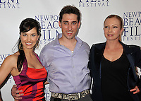 """AMIE BARSKY, PAUL J. ALESSI, producer/actor & TRACI LORDS.""""Knuckle Draggers"""" Premiere at the 2009 Newport Beach Film Festival held at Edwards Cinemas, Newport Beach, CA, USA..April 27th, 2009.half length black purple shirt jacket tracey tracy blue silk satin red dress amy aimee.CAP/ADM/BP.©Byron Purvis/AdMedia/Capital Pictures."""