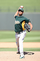Edwar Ramirez, Oakland Athletics, pitching in a spring training game against the Kansas City Royals at Surprise Stadium, Surprise, AZ - 03/27/2010..Photo by:  Bill Mitchell/Four Seam Images.