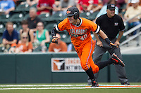 Oklahoma State Cowboys third baseman Craig McConaughy #40 sprints off of first base during the NCAA baseball game against the Texas Longhorns on April 26, 2014 at UFCU Disch–Falk Field in Austin, Texas. The Cowboys defeated the Longhorns 2-1. (Andrew Woolley/Four Seam Images)