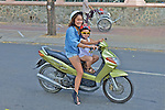 Woman and Child On Scooter