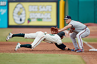 Rome Braves first baseman Bryce Ball (12) waits for a pick-off throw as Jared Triolo (19) of the Greensboro Grasshoppers dives back to the base at First National Bank Field on May 16, 2021 in Greensboro, North Carolina. (Brian Westerholt/Four Seam Images)