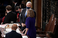 Vice President Mike Pence speaks to Speaker Nancy Pelosi (D-Calif.) during a joint session of Congress to count the Electoral College votes from the 2020 presidential election on Wednesday, January 6, 2021.<br /> CAP/MPI/RS<br /> ©RS/MPI/Capital Pictures