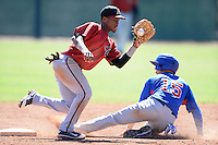 Arizona Diamondbacks second baseman Fernery Ozuna (2) takes the throw as Daniel Lockhart (15) slides in safely during an Instructional League game against the Chicago Cubs on October 5, 2013 at Salt River Fields at Talking Stick in Scottsdale, Arizona.  (Mike Janes/Four Seam Images)