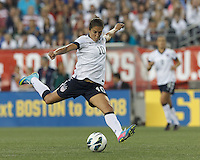 USWNT midfielder Carli Lloyd (10) takes a scoring shot. In an international friendly, the U.S. Women's National Team (USWNT) (white/blue) defeated Korea Republic (South Korea) (red/blue), 4-1, at Gillette Stadium on June 15, 2013.