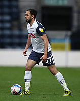 20th April 2021; Deepdale, Preston, Lancashire, England; English Football League Championship Football, Preston North End versus Derby County; Greg Cunningham of Preston North End looks up before passing the ball