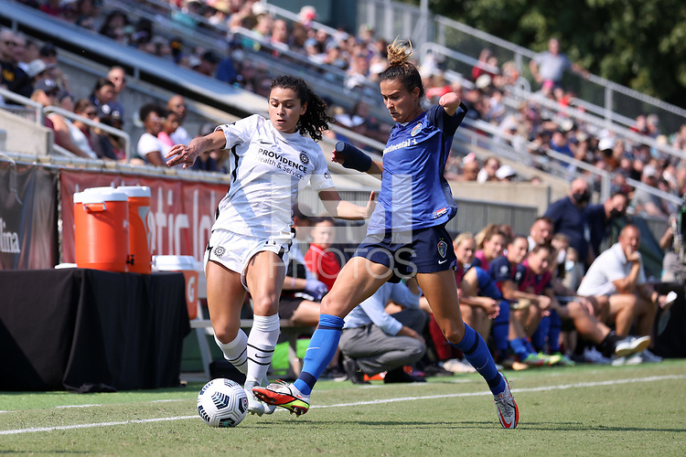 CARY, NC - SEPTEMBER 12: Carson Pickett #4 of the North Carolina Courage knocks the ball away from Rocky Rodriguez #11 of the Portland Thorns FC during a game between Portland Thorns FC and North Carolina Courage at Sahlen's Stadium at WakeMed Soccer Park on September 12, 2021 in Cary, North Carolina.