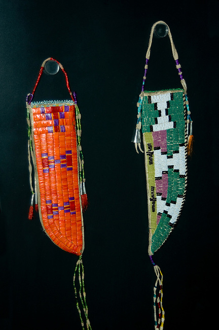 The Mandan, Arikara and Hidatsa women would spend long winters creating beautiful crafts such as decorating these knife sheaths with beadwork and porcupine quillwork.