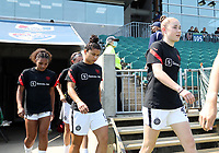 CARY, NC - SEPTEMBER 12: Olivia Moultrie #42, Rocky Rodriguez #11, and Yazmeen Ryan #23 of the Portland Thorns FC take the field before a game between Portland Thorns FC and North Carolina Courage at Sahlen's Stadium at WakeMed Soccer Park on September 12, 2021 in Cary, North Carolina.