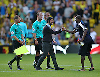 Quique Flores manager of Watford shakes hands with Odion Ighalo of Watford   during the Barclays Premier League match Watford and Swansea   played at Vicarage Road Stadium , Watford