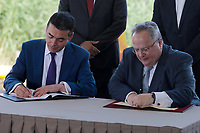 Pictured: (L-R), Nikola Dimitrov Minister of Foreign Affairs of FYROM and Greek foreign minister Nikos Kotzias at Prespa Lake in northern Greece. Sunday 17 June 2018 <br /> Re: Greece and the Former Yugoslav Republic Of Macedonia (FYROM) have signed a deal that aims to settle a decades-long dispute over the country's name.<br /> Under the agreement, Greece's neighbour will be known as North Macedonia.<br /> Heated rows over Macedonia's name have been going on since the break-up of the former Yugoslavia, of which it was a part, and have held up Macedonia's entry to Nato and the EU.<br /> Greece has long argued that by using the name Macedonia, its neighbour was implying it had a claim on the northern Greek province also called Macedonia.<br /> The two countries' leaders, Mr Tsipras and his Macedonian counterpart Zoran Zaev announced the deal on Tuesday and have pressed ahead despite protests.<br /> The two countries' foreign ministers signed the deal on Lake Prespa on Greece's northern border on Sunday.<br /> The agreement still needs to be approved by both parliaments and by a referendum in Macedonia.