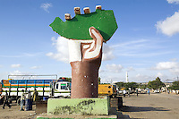 Somaliland. Waqohi Galbed province. Hargeisa. Memorial monument. A hand holds in its fingers the map of Somaliland, painted in green the color of islam. A group of black muslim talk close to a truck. After a long war, on May 18, 1991, the major Somaliland clan, namely Isaqs, declared independence from the Somalia. Somaliland is an unrecognized de facto sovereign state located in the Horn of Africa. Hargeisa is the capital of Somaliland. © 2006 Didier Ruef