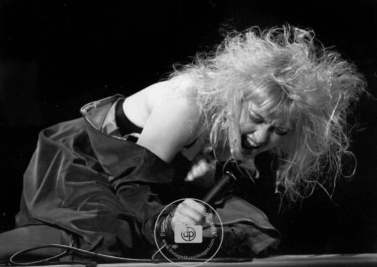 Cyndi Lauper performing at a show in the 1980s. © David Plastik / Retna Ltd.