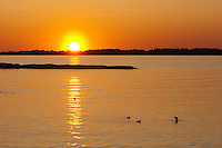 Sunrise greets with colorful passion in the archipelago off Pookinmaa Island -Southwestern Finland.