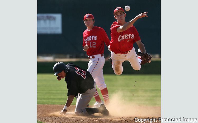 Palomar's Matt Gabrielson makes the throw to first but couldn't turn the double play<br /> at Palomar College.  photo for North County Times