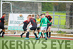 Park FC clear their defence as Listowel Celtic go in search of a score, in the Denny Youths final
