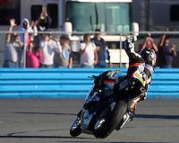 Jason DiSalvo waves to fans after winning the Daytona 200 motorcycle race at Daytona International Speedway, Daytona Beach, FL, March 2011.(Photo by Brian Cleary/www.bcpix.com)