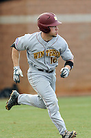 Designated hitter Roger Gonzalez (16) of the Winthrop University Eagles runs toward first in a game against the University of South Carolina Upstate Spartans on Wednesday, March 4, 2015, at Cleveland S. Harley Park in Spartanburg, South Carolina. Upstate won, 12-3. (Tom Priddy/Four Seam Images)