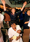 Evangelical Congregation church service UK. Elim Pentecostal Sunday church service Kensington Temple. Mother and baby multi racial congregation London<br />
