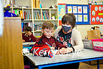 Pupils back in school in Moyderwell primary school on Wednesday Michael Collins with Teacher Jill O'Brien.