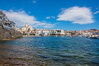 Spain, Costa Brava, Catalonia, Cadques. Harbor beach wih boats.