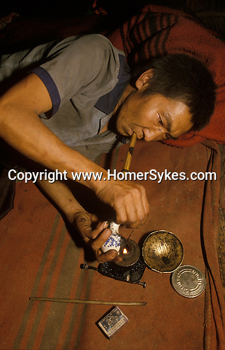 Chasing the dragon opium addict Northern Thailand. South East Asia. Chiang Rai province.