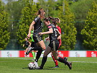 Hannah Eurlings (9) of OHL lifts her log to make way for the ball of Marie Detruyer (17) of OHL during a female soccer game between Standard Femina de Liege and Oud Heverlee Leuven on the 10th and last matchday in play off 1 of the 2020 - 2021 season of Belgian Scooore Womens Super League , saturday 29 th of May 2021  in Angleur , Belgium . PHOTO SPORTPIX.BE | SPP | SEVIL OKTEM