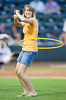 A young female fan participates in a hula-hoop contest between innings of the Carolina League game between the Wilmington Blue Rocks and the Winston-Salem Dash at BB&T Ballpark on August 3, 2011 in Winston-Salem, North Carolina.  The Blue Rocks defeated the Dash 6-2.   Brian Westerholt / Four Seam Images