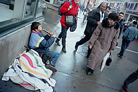 Montreal, 1999-11-23. Beggar playing the flute on Ste-Catherine street West in downtown Montreal (Quebec, Canada)<br /> Photo : (c) Pierre Roussel, 1999