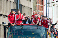 CARDIFF, UK. 8th July 2016. The Welsh football team are welcomed home with a public celebration event after reaching the semi-final of the Euro 2016 championship. After landing at Cardiff airport, an open-top bus parade took them through the city centre.<br /> <br /> L-R: Ashley Williams, Gareth Bale, Chris Coleman, Chris Gunter (standing), Aaron Ramsey, Wayne Hennessey