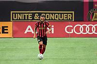 ATLANTA, GA - AUGUST 29: Anton Walkes #4 of Atlanta United dribbles the ball during a game between Orlando City SC and Atlanta United FC at Marecedes-Benz Stadium on August 29, 2020 in Atlanta, Georgia.