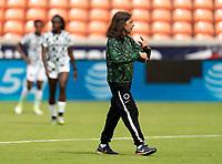 HOUSTON, TX - JUNE 10: Lauren Gregg of Nigeria watches the team before a game between Nigeria and Jamaica at BBVA Stadium on June 10, 2021 in Houston, Texas.