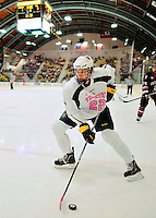 28 January 2012: University of Vermont Catamount defenseman Blake Doerring, a Freshman from Chanhassen, MN, controls the puck against the Northeastern University Huskies at Gutterson Fieldhouse in Burlington, Vermont. The Catamounts, dressed in their Breast Cancer Awareness jerseys, fell to the Huskies 4-2 in the second game of their 2-game Hockey East weekend series. Mandatory Credit: Ed Wolfstein Photo