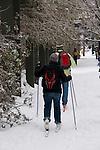 People skiing on the city sidewalk, downtown Portland, Oregon