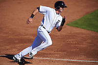 Scottsdale Scorpions outfielder Mike Gerber (9) running the bases during an Arizona Fall League game against the Surprise Saguaros on October 22, 2015 at Scottsdale Stadium in Scottsdale, Arizona.  Surprise defeated Scottsdale 7-6.  (Mike Janes/Four Seam Images)