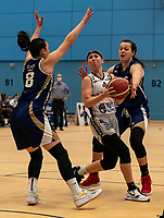 Maddy McVicar of Newcastle Eagles battles through the Suns defence during the WBBL Championship match between Sevenoaks Suns and Newcastle Eagles at Surrey Sports Park, Guildford, England on 20 March 2021. Photo by Liam McAvoy