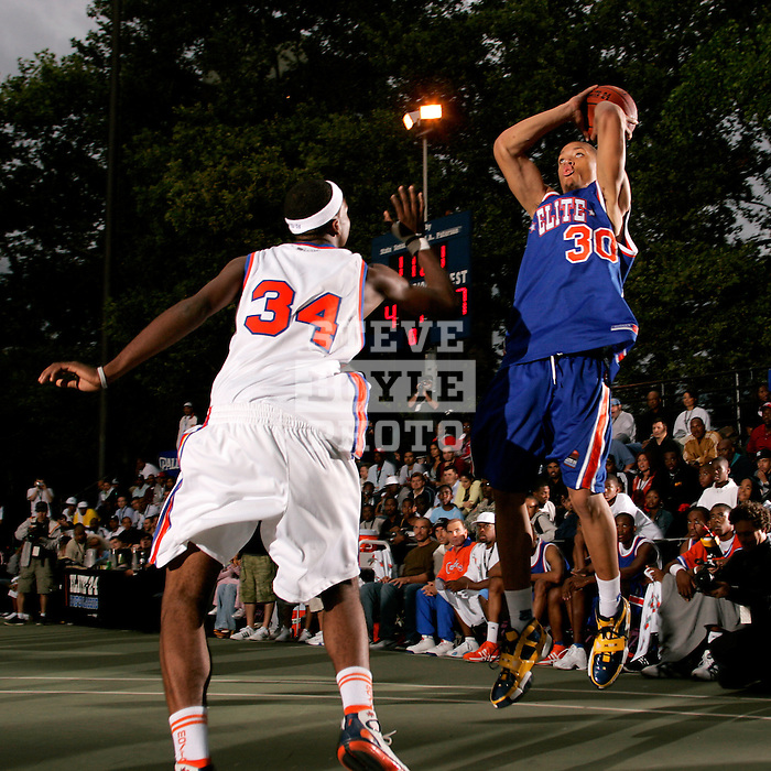 Michael Beasley (30) takes a shot over Donte Greene (34) during the Elite 24 Hoops Classic game on September 1, 2006 held at Rucker Park in New York, New York.  The game brought together the top 24 high school basketball players in the country regardless of class or sneaker affiliation.