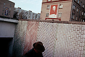 "Moscow, Russia<br /> October 21, 1992<br /> <br /> A Lenin poster hangs over a small market in the Moscow suburbs.<br /> <br /> In December 1991, food shortages in central Russia had prompted food rationing in the Moscow area for the first time since World War II. Amid steady collapse, Soviet President Gorbachev and his government continued to oppose rapid market reforms like Yavlinsky's ""500 Days"" program. To break Gorbachev's opposition, Yeltsin decided to disband the USSR in accordance with the Treaty of the Union of 1922 and thereby remove Gorbachev and the Soviet government from power. The step was also enthusiastically supported by the governments of Ukraine and Belarus, which were parties of the Treaty of 1922 along with Russia.<br /> <br /> On December 21, 1991, representatives of all member republics except Georgia signed the Alma-Ata Protocol, in which they confirmed the dissolution of the Union. That same day, all former-Soviet republics agreed to join the CIS, with the exception of the three Baltic States."