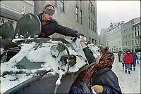 "ROMANIA, Calea Victoriei, Bucharest, 25.12.1989<br /> People rise against Ceausescu. The dictator has fled the city on dec. 22. At the central square intense figting with unidentifiable ""terrorists"" has been going on. Woman offering thick socks to a soldier ontop a BTR-80 personnel carrier.<br /> © Andrei Pandele / EST&OST"