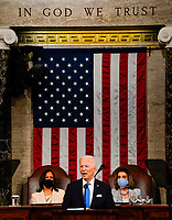 WASHINGTON, DC - APRIL 28: President Joe Biden addresses a joint session of Congress, with Vice President Kamala Harris and House Speaker Nancy Pelosi (D-Calif.) on the dais behind him, on Wednesday, April 28, 2021. Biden spoke to a nation seeking to emerge from twin crises of pandemic and economic slide in his first speech to a joint session of Congress. <br /> CAP/MPI/RS<br /> ©RS/MPI/Capital Pictures