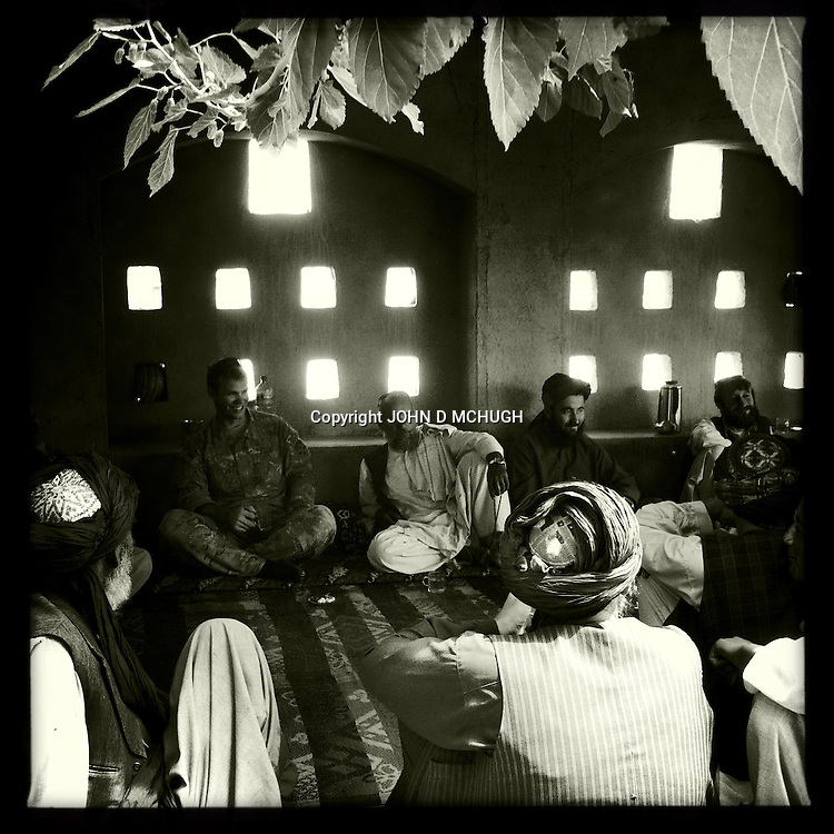 1 Platoon, Delta Co, 1-66, 4th Infantry Division, hold a Shura (meeting) with local elders in Arghandab Valley, Kandahar, 28 April 2011. (John D McHugh)