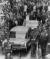 1968 FILE PHOTO - ARCHIVES -<br /> <br /> Funeral procession for Quebec Premier Daniel Johnson winds slowly through a gray drizzle today for solemn funeral mass at the Basilique de Quebec. After the mass, celebrated by Maurice Cardinal Roy, the body was taken to Montreal to lie in state there until burial tomorrow in Johnson's home riding, Bagot.<br /> <br /> 1968<br /> <br /> PHOTO : Graham Bezant - Toronto Star Archives - AQP