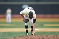 Wake Forest Demon Deacons relief pitcher Tyler Witt (12) makes a mark in the mound during the game against the Miami Hurricanes at David F. Couch Ballpark on May 11, 2019 in  Winston-Salem, North Carolina. The Hurricanes defeated the Demon Deacons 8-4. (Brian Westerholt/Four Seam Images)
