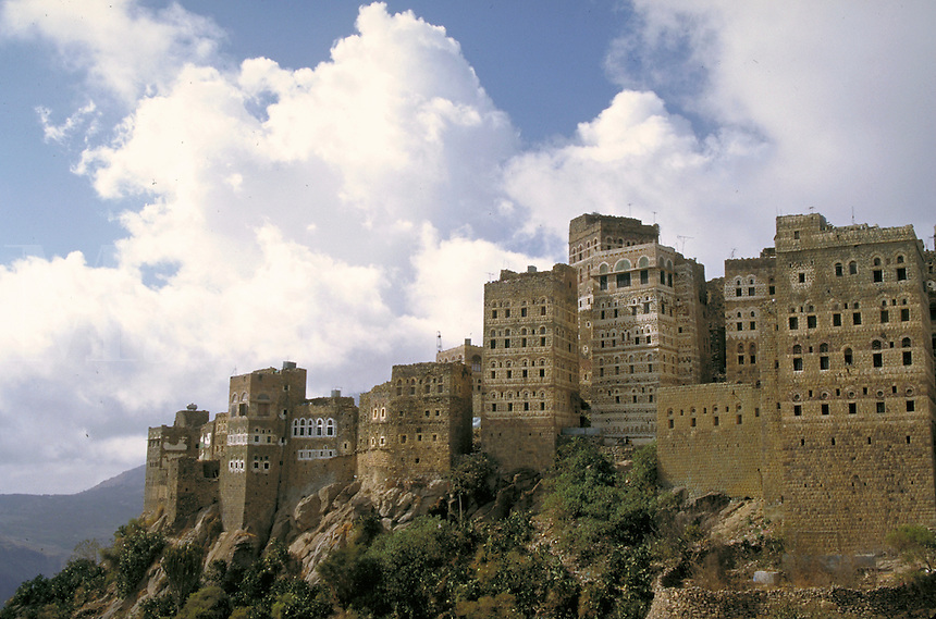 Painted mud bricks and stone form this decorative cityscape. Manakha, Yemen.