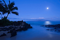 A full moon sets over Kahoolawe as seen from Makena, Maui.