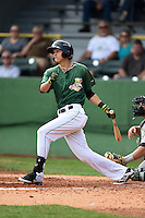 Clinton LumberKings shortstop Luis Caballero (10) at bat during a game against the Beloit Snappers on August 17, 2014 at Ashford University Field in Clinton, Iowa.  Clinton defeated Beloit 4-3.  (Mike Janes/Four Seam Images)