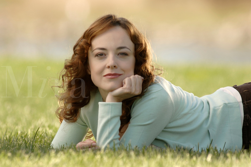 Casual woman relaxing on the lawn.