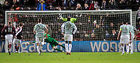 28.11.2012 Edinburgh, Scotland. Fraser Forster and Marius Zaliukas in action during the Scottish Premier League game between Heart of Midlothian and Celtic from Tynecastle Stadium.